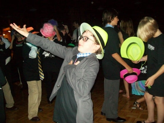 boy dancing showing off at bar mitzvah