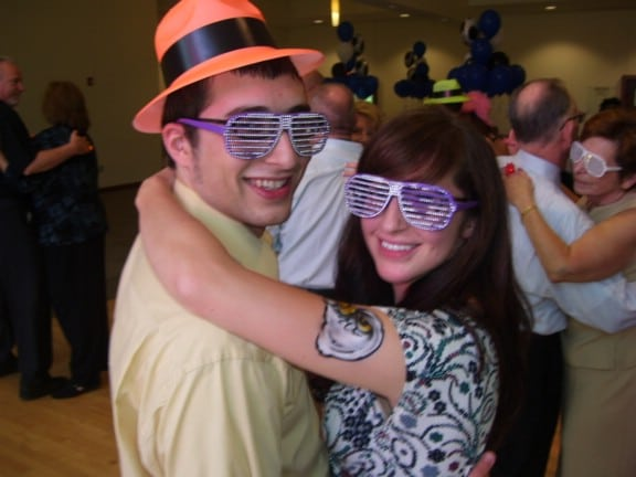 guests decked out in novelties dancing together